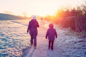 0_Mother-and-son-walking-through-a-park-in-winter